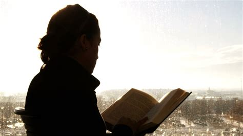 picture of someone reading a book silhouette of a person reading a book