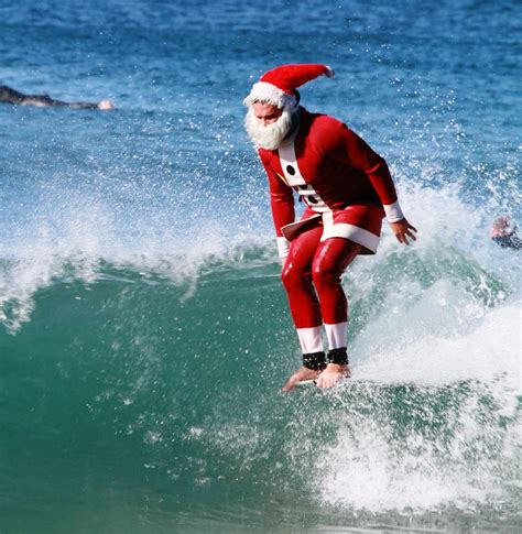 santa on surfboard surfing santa spotted in el porto photos