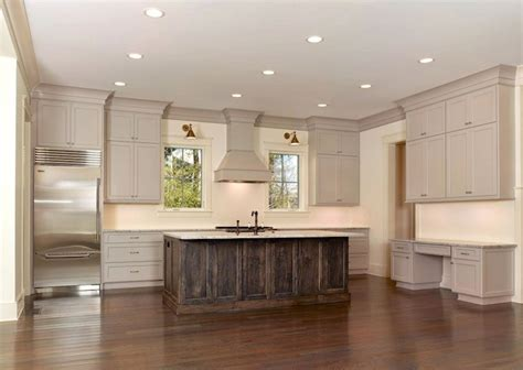 Kitchen Cabinets With Molding Amazing Kitchen Featuring Taupe Kitchen Cabinets With Taupe Crown Molding And Granite
