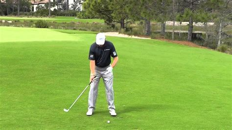 solid golf swing ernie els shows you how to hit the ball more solid mel