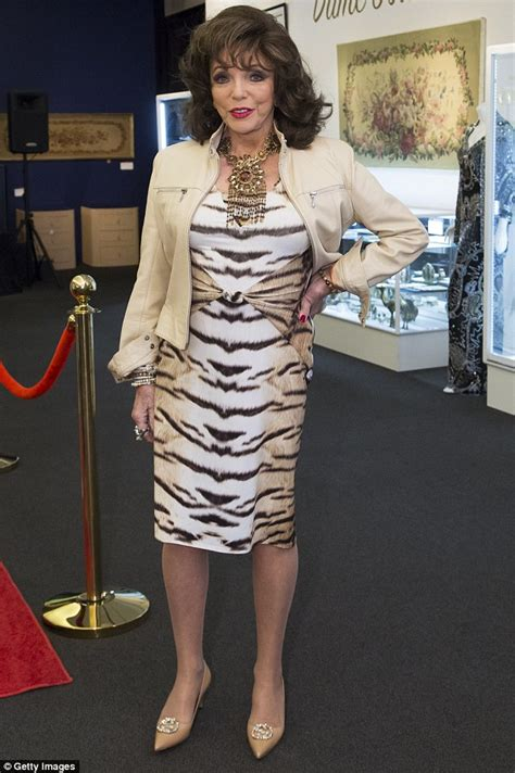 Wardrobe Dress by Joan Collins Wears Animal Print Dress Before Auctioning