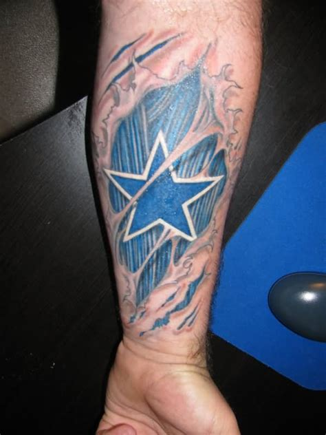tattoo ink pulled out blue ink ripped skin cowboy star tattoo on forearm