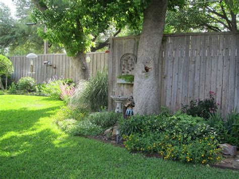 backyard fence landscaping ideas flower bed along fence staggered instead of boring usual