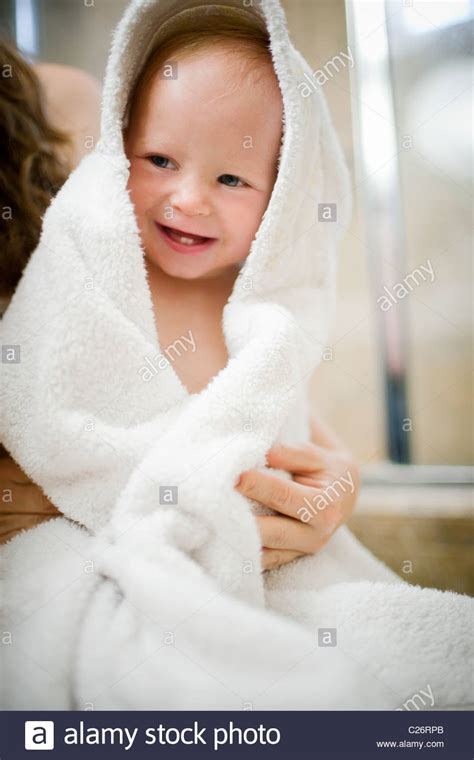 bathtub for 1 year old baby mother drying off 1 year old baby girl after bath stock photo royalty free image