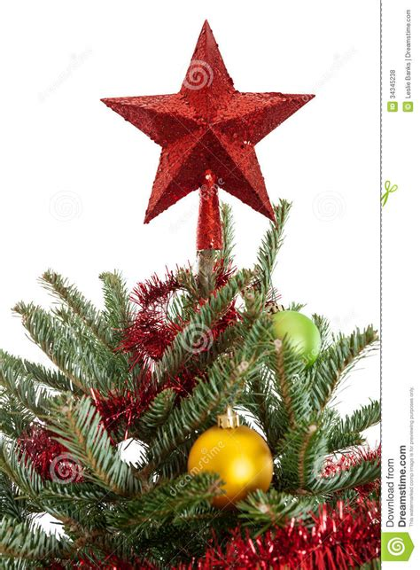 star on top of a christmas tree royalty free stock photos