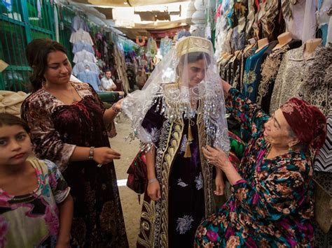 uzbek women selling traditional wedding skullcaps and dresses sunday uzbek women shopping a wedding dress bukhara uzbekistan
