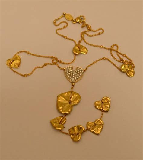 collana in oro giallo leaf con pendenti a forma di cuore