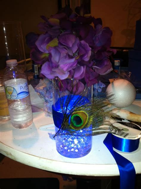 centerpiece trials for peacock themed evening wedding
