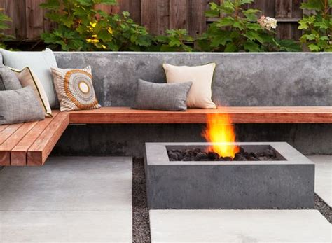 wooden fire pit bench wood bench wraps around a low concrete fire pit arterra