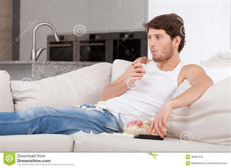the man on the couch bored man lying on couch royalty free stock images image