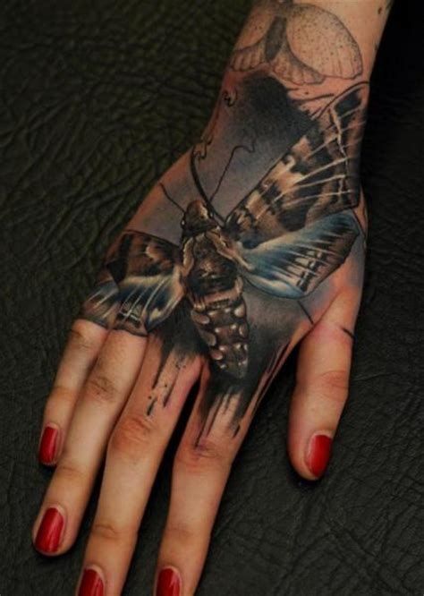 Tattoo Hand Realistic | realistic hand moth tattoo by vicious circle tattoo