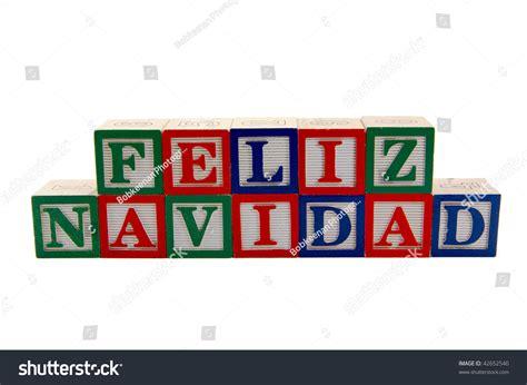 green red  blue wood toy alphabet blocks spelling feliz navidad  merry christmas