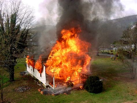 house on fire fire free stock photo a house on fire 12708
