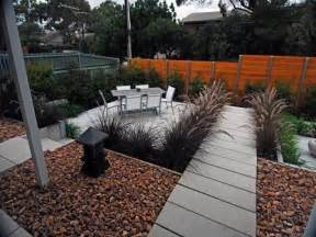 Low maintenance garden design using pavers with outdoor dining