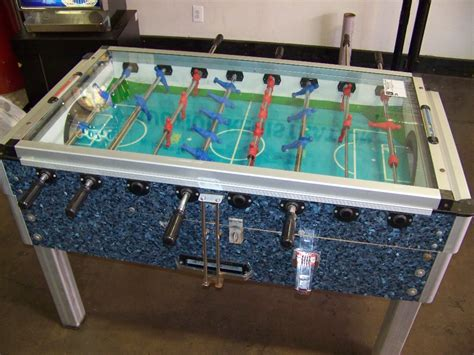 foosball table with glass top item is in used condition evidence of wear and commercial