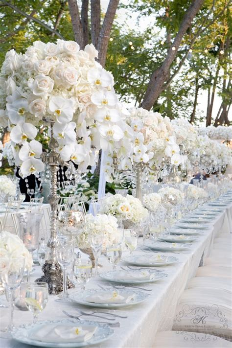 wedding roses centerpieces white wedding centerpiece on silver candelabra with roses hydrangea and phalaenopsis orchids