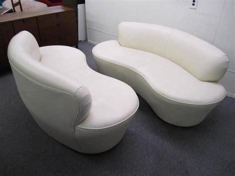 kidney shaped sofas pair kidney shaped kagan inspired putty leather sofa