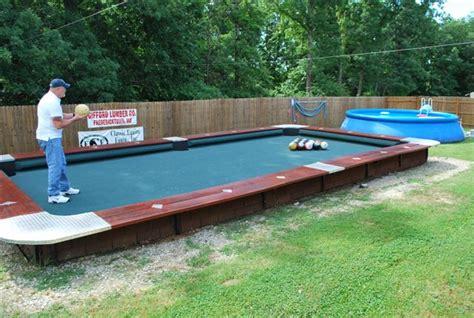 you won t believe this life size backyard pool bowling