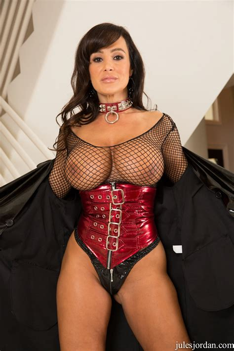 lisa ann in sexy fishnet corset and high boots poses for