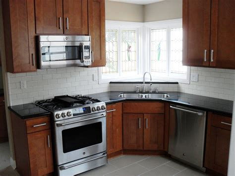 black subway tile kitchen backsplash white subway tile backsplash black countertop medium cabinets replace with white