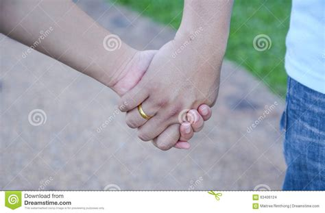 images of love hands together two pairs of hands in love tenderly hold together stock