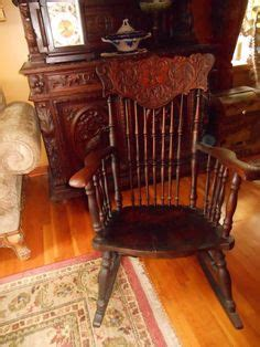 antique northwind large oak rocking chair  carved face
