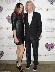 mel c shows off her toned legs in a backless leather