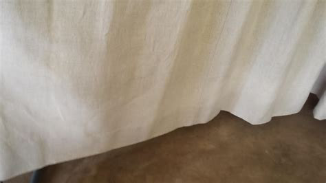 Cleaning Urine From Upholstery by Cleaning Linen Drapes Stained With Water And Clean Linen
