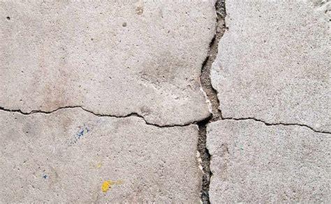 what causes cracks in basement floors everdry toledo ohio