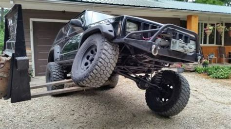 purchase   xj jeep rock crawler trail rig daily driver cherokee  door  invested