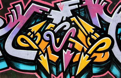 twisted arrows graffiti wallpaper mural murals wallpaper