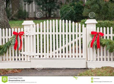 images of christmas garland on a fences white picket fence garland and bow iv stock photo image 35443626
