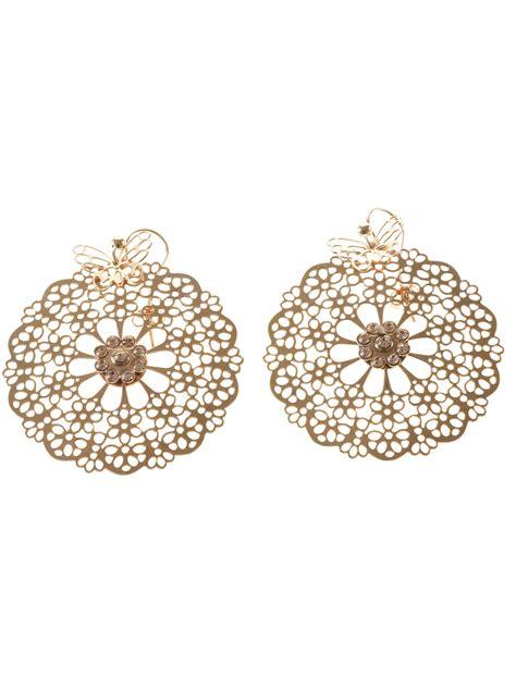 flower design earrings gas bijoux stainglass flower design earrings in metallic