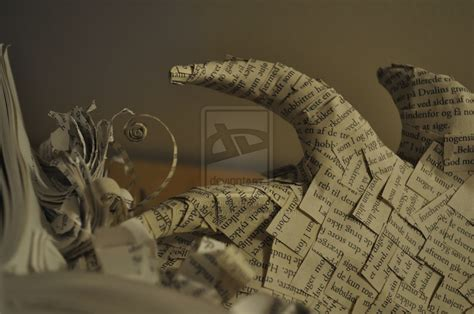book sculpture smaug emerging from artist turns the hobbit book into paper sculpture of smaug kotaku australia