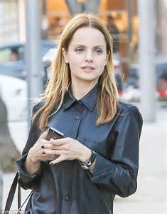 mena suvari matches her black leather button up while