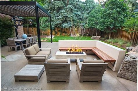 outdoor seating area with cover l shaped wood decking seating and armchairs with cushions