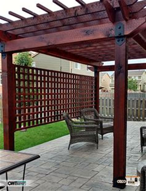 black pergola hardware pergola divider with sted concrete patio using owt hardware creates a relaxing backyard