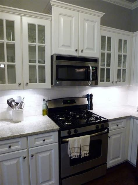 over the range microwave without cabinet bump up the cabinets above stove to make more room for