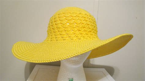 yellow hat pattern enjoying a few moments of crocheting a summer beach hat