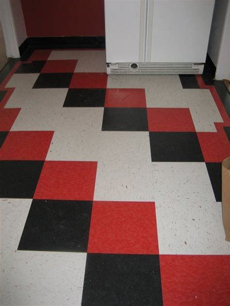 cherry red, black and white checkerboard floor