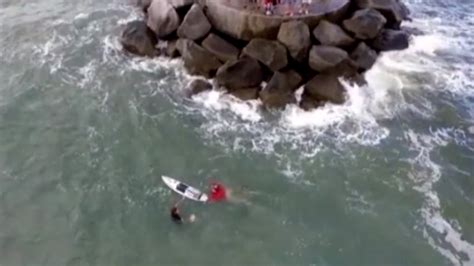 boat sinks in jupiter inlet 8th grader on surfboard saves from capsized boat