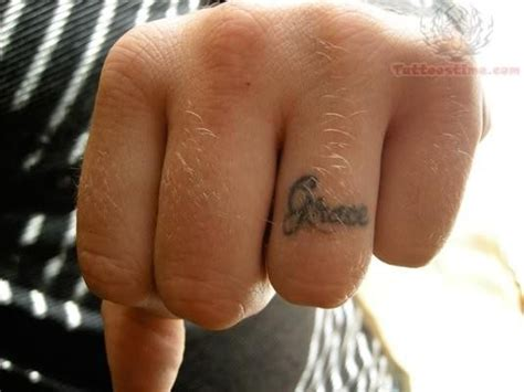 tattoo initials finger initial ring tattoo finger