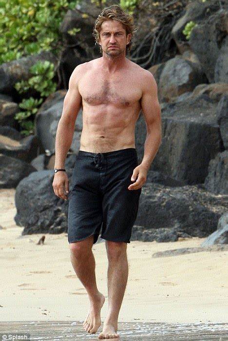 gerard butler makes waves as he strips off on surfing