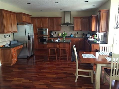 gray paint with cherry cabinets paint color for open kitchen living room with lots of
