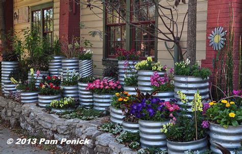 Culvert Pipe Planters by Drive By Gardens Colorful Culvert Pipe Planters In