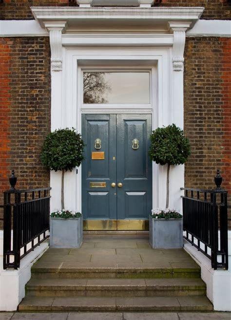 Brass Kick Plates For Front Doors Doors With Brass Knockers Brass Kick Plates And Potted Trees A