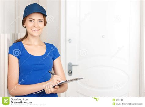 Everyone A Charmer by Deliverywoman Standing Near Door Stock Photo Image