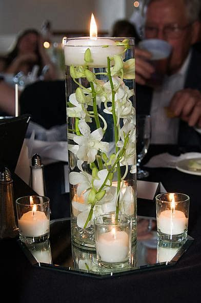love the floating candle with submerged orchid as an idea