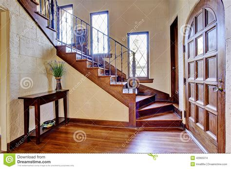 luxury house interior entrance hallway with staircase