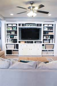 the basement built in entertainment center bookshelves